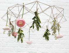 Decorate your walls with intriguing geometric ornaments like this copper iron wire Himmeli wreath decoration. Attach silk flowers to this lightweight wreath to create a modern look for your holiday ho