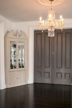 Slate Grey Interior Doors, White Walls lend contrast and drama. TO DO DOORS IN BLACK, WITH BLACK FLOOR, WHITE/LIGHT GREY WALLS