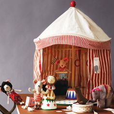 Maileg's vintage-style Circus Tent is the perfect place for your Maileg mice to perform! Hand crafted from candy-striped canvas fabric and featuring wooden accessories.