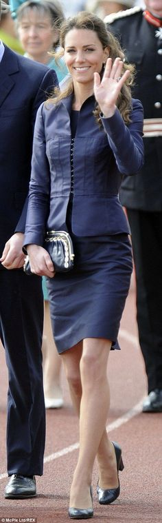 Fit for a Queen: The Duchess of Cambridge in a conservative navy blue suit...    9