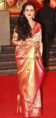 Rekha. off white pure kanjeevaram zari saree with pink border.
