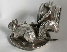ANTIQUE SILVER PLATED NAPKIN RING WITH A SQUIRREL