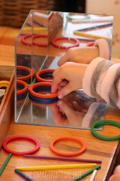 Exploring with loose parts in a mirror cube (can make your own mirror box with acrylic mirror tiles)