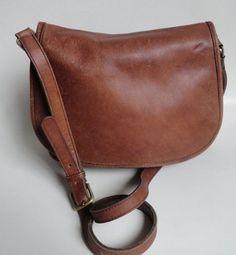 Vintage Coach Tan Leather Saddle Bag Purse. $124.00, via Etsy.
