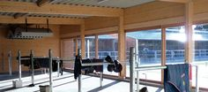 Horse grooming stalls with large windows. Riding arena construction - SCHLOSSER Riding arena construction