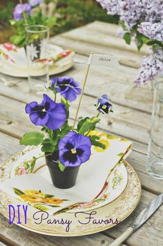 Cute idea for favors. works for flowers/centerpieces/favors all at the same time. DIY Pansy Favors