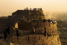 People visiting the historical Derawar Fort in Cholistan desert, Pakistan. Derawar fort is the largest and the most superlatively preserved fort of Cholistan. The powerful fort was built in 1733 by the rulers of the state of Bahawalpur and it towers are visible from miles around. Omer Saleem / EPA