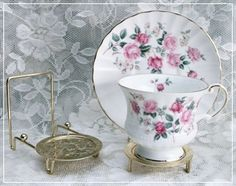"""$3.75 brass tea cup display stand depth of unit is 3.25"""" - to display cups and saucers"""