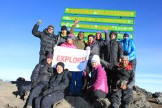 The Explore flag is proudly unfurled at the summit of Mount Kilimanjaro - Mount Kilimanjaro, Small Groups, Tanzania, Trekking, Africa, Flag, Tours, Explore, Adventure