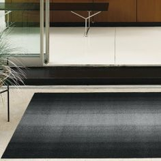 Chilewich - Ombre Shag Floormat by Chilewich. $45.00. Given the nature of the process used to make Shag, the heavy-duty, high-texture, indoor/outdoor floormats, stripes are the only producible pattern. Never daunted by a manufacturing limitation, Chilewich introduces an Ombre that moves from light to dark. Good in all weather. Quick to dry. Resists mold and mildew. Utility Mat and Doormat have vertical stripes and Big Mat has horizontal stripes. Made in USA.