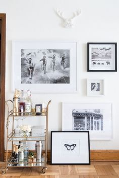 The bar cart is framed out in mirrored glass to reflect more light into the space. And as you can see black and white art is throughout the apartment. Believe it or not, it was rather inexpensive, simply printed from Staples and hung in Ikea frames.