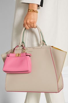 Baby-pink leather (Lamb), dark-brown suede (Calf) Turn lock fastenings at top Weighs approximately 1.1lbs/ 0.5kg  Made in Italy
