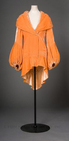 Velvet evening coat c. The FIDM Museum velvet evening coat seen here is an enticing shade of rich, bright orange. During the and into the this particular color was sometimes called nasturtium after the orange flower of the same name. 1930s Fashion, Moda Fashion, Vintage Fashion, Victorian Fashion, Fashion Fashion, Vintage Outfits, Vintage Dresses, Antique Clothing, Historical Clothing