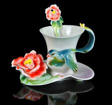 Lovely bird and flower cup and saucer, tea cup.  Anyone for a tea party?