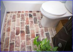 mud room/laundry room/ guest bathroom or really for the kitchen backsplash... Red Brick Tile ...
