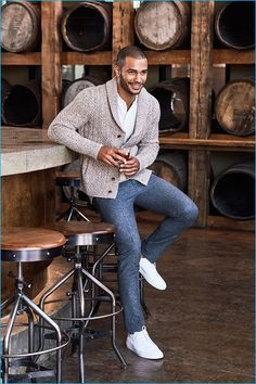 Nathan Owens is all smiles in a shawl neck cardigan sweater from Bonobos.