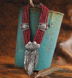 "Crow's Nest Exclusive.   Intricately detailed silver feathers are joined to five strands of rare antique red ""whiteheart"" glass beads with silver buttons. 12"" collar with 5½"" extender. Mummy's Bundle. Made in the USA."