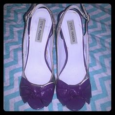 "Steve Madden purple floral bow wedge heels 7.5 Cute and fun ""Gracee"" wedge heels by Steve Madden, size 7.5, feature an adorable purple bow above the peep-toe, floral pattern with buckled sling back and solid purple heel. Worn twice so minor signs of wear as shown. Steve Madden Shoes Wedges"