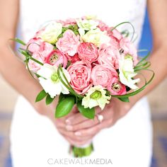 bridal bouquet by v&j plant shop flowers in bouquet: anemones, raununculus, garden roses  . photography by cakewalkmedia.ca