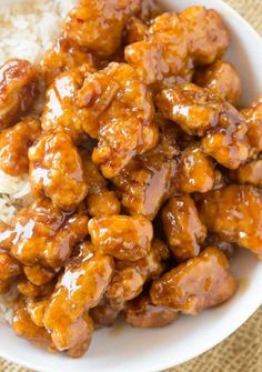 Tender chicken thighs fried crisp and tossed in a magical perfect-copycat Panda Express Orange Chicken Sauce! You'll save a fortune and skip the lines!