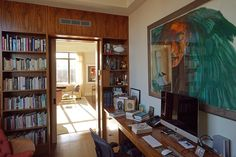 """Home for the actor is the Upper West Side. Lately, he's been walking to work: His film, """"Anesthesia"""" was shot in the neighborhood.   """"The 16th Angel to the Jews,"""" a gouache by Leonard Baskin, hangs over the tiger maple desk in Mr. Nelson's office. Nicole Bengiveno/The New York Times"""