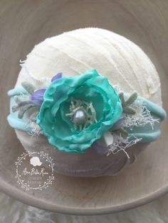 ZoeTieback  / Willow Baby CollectionSize   Newborn to AdultsColor   Sea Foam/Teal/Mint Green/LavenderDetails   Delicate rose adorns , hand Sewn Natural Pearl, Vintage Lace, Mint Green leaves