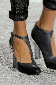Chanel.  Beautiful shoes... my feet would be very happy in these. <3
