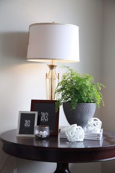 Wonderland by Alice Lane   Side table vignette with gold lamp and fern