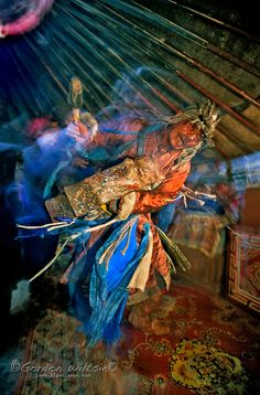 Tsaagan Nur, Mongolia - A traditional shaman beats his drum, dances and chants to put himself into a trance. - Gordon Wiltsie - Shaman are spiritual beings with the ability to heal, work with energies and 'see' visions.