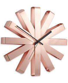 Keep track of the time in style! Umbra's Ribbon Wall Clock features a unique design with red hands and a stainless steel finish for a completely modern look. Designed by Michelle Ivankovic for Umbra. Mais