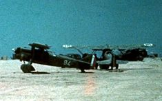 A rare colour shot showing two Fiat CR.32s of 94a Squadriglia, 8o Gruppo Caccia in early 1940 at Castel Benito, Libya. The unit was transferred to Tobruk a few days before the outbreak of the war for Italy and it was the first Regia Aeronautica unit to engage the enemy in North Africa on 11 June 1940.