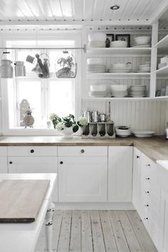 White kitchen, light countertops