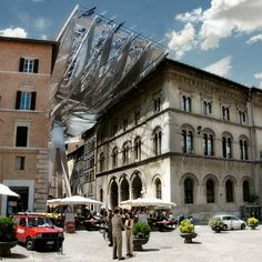 Austrian architects Coop Himmelb(l)au have designed an energy-generating canopy for a passageway in Perugia, Italy.