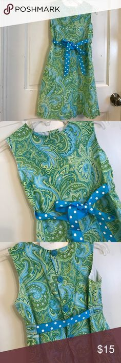Girls Blue/Green sheath dress This is a BAILEY BOYS speciality line called CHABRE'. This boutique dress came from the Bailey Boys retail store on St. Simons Island, GA.  This unique BLUE/GREEN Shift dress features a flower pattern and has an Aqua Polka Dot Ribbon at the waist that ties in the front or back.   There is a 5 button closure on the back Fully lined Size 8, 27 inches Size 10,   This dress comes from a smoke free home and has had minimal wear.  No visible stains and has always been…