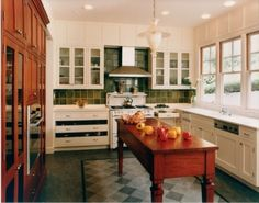 mediterranean kitchen by Mueller Nicholls Cabinets and Construction. Not my style but I really like the layout.