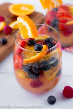 Sparkling Fruit Sangria filled with champagne, berries, oranges, and more. There's always a reason for celebrating with sangria!