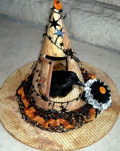 Love this witch hat - raven house!  Looks like podge podge on newspaper and leather for hinges hmm..