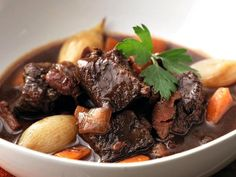 Beef Bourguignon--Boeuf Bourguignon, a classic French stew originating from the Burgundy region. Boneless Beef Short Ribs, Meat Recipes, Cooking Recipes, Classic French Dishes, French Food, Food Porn, Beef Dishes, Meat Dish, Fabulous Foods