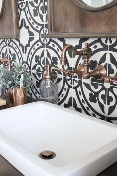 Master Bathroom Renovation- bathroom- remodeled bathroom- bathroom- cement tile- copper accents- bathroom update- bathroom reveal- black and white patterned tiles