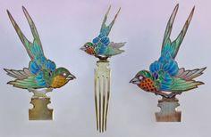 BRITISH ARTS & CRAFTS Swallow Hair Comb   Gilded silver Plique-à-jour enamel  H: 18 cm (7.09 in)  W: 6.5 cm (2.56 in)  British, c.1900