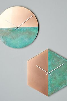 copper clocks in hexagon or circle shapes