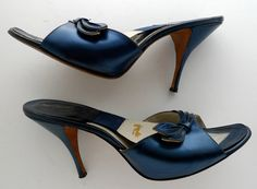 """Vintage blue springolator high heel shoes from Galliano Custom Footwear. Lovely leaf-like details. An ideal vintage shoe, perfect for burlesque, rockabilly, Viva Las Vegas!    Marked a 9 S  Interior Length: 10 1/8""""  Interior Width: 3""""  Heel Height: 3""""    Probably somewhere around a size 8 or 8.5. Measure your foot to be sure!    These shoes are in excellent condition. Some slight wear on the leather sole and the elastic is nice and taut.    More blue items…"""