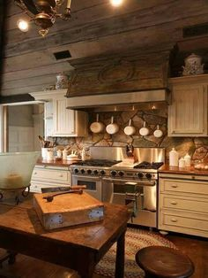 kitchen, stone backsplash, copper pots wooden butcher's block island #Kitchen Vent Hood Idea