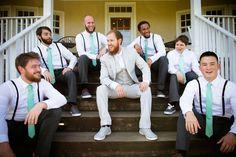 Hipster groomsmen in black pants, suspenders  Teal ties. Groom in light grey. From Brittany  Dave's coral  mint, DIY Virginia wedding. Images by Traci J Brooks Studios.