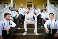Hipster groomsmen in black pants, suspenders & Teal ties. Groom in light grey. From Brittany & Dave's coral & mint, DIY Virginia wedding. Images by Traci J Brooks Studios.