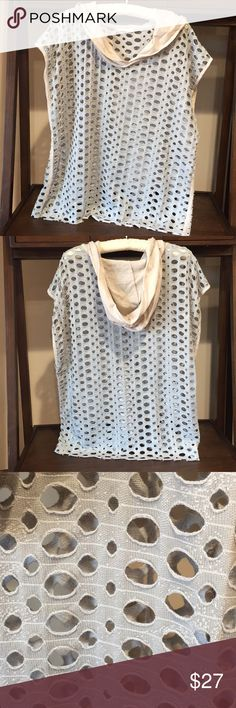 Anthropologie top by easel open detailhood size L Anthropologie top by easel has open weave detail with hood. The body of garment is light gray and hood is cream shade. The arm openings are wide and gives this top a poncho style. Tags was removed because it showed through open weave. The material is a cotton blend. Underarm to underarm 22 3/4 inches. Shoulder to bottom hem 25 1/4 inches Anthropologie Tops