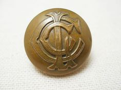 イギリスLondon Ambulance Brigadeの制服のボタンとして使われていたユニフォームボタンです。1930年代頃の古いタイプのボタンで、モノグラムのモチーフがクールです。