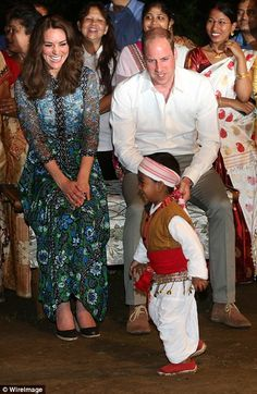 Duchess of Cambridge and her husband Prince William watch a 3 year old boy dance for them