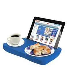 iBed – iPad Lap DeskTake working, reading, and watching movies in bed to a whole new level. With a slot for your iPad and a surface for your favorite snacks, this is a must-have for Sunday afternoons.  To buy: $13, rakuten.com.