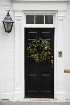 wreath, black door, white trim